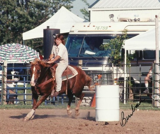 Here's my old horse, See Sum Hum and me.  We are both clearly past our prime, but we were having fun that day running the barrels.